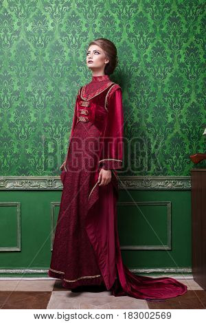 Gorgeous woman dressed in vintage clothes in retro interior. Rococo period. Luxury and high class