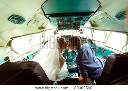 Couple In The Cabin Of The Plane In The Wedding Day