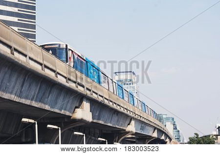 Bts Sky Train Mass Transit System ,moving To Arrive In Platform Of Central Business Area Of Bangkok.