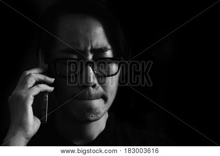 Portrait unhappy young woman talking on mobile phone looking down. Human face expression emotion bad news reaction in white tone