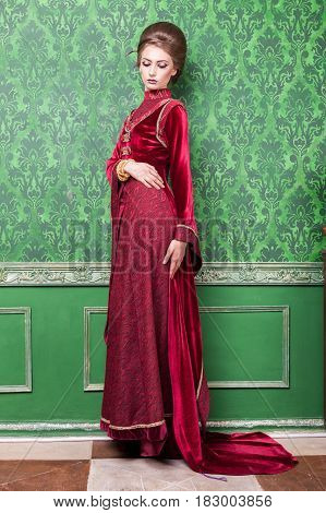 Charming woman dressed vintage clothes in retro interior. Rococo period. Luxury and high class