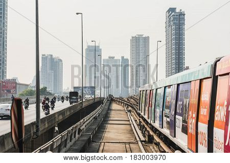 Bangkok-Thailand Feb 28 2017: BTS Sky train mass transit system moving to arrive in platform of central business area of Bangkok.