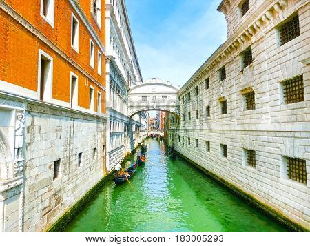 Venice, Italy - Gondolas and boats on Canal Grande in Venice, in a beautiful summer day in Italy