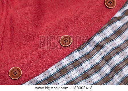 photo of cool fashionable look of shirt and cardigan in close-up