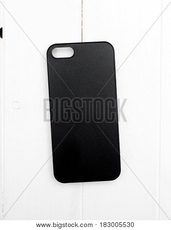Simple and elegant black smartphone case on white table, comfy to grab, topview