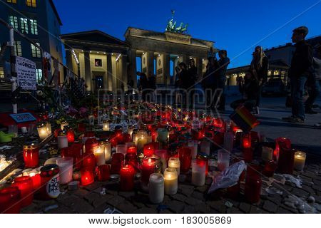 BERLIN - JUNE 20 2016: Pray for Orlando. Candles in memory of the victims of the shooting at the club Pulse in Orlando near the US Embassy on Pariser Platz in front of the Brandenburg Gate.