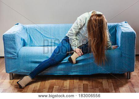 Sad Depressed Woman On Sofa At Home.