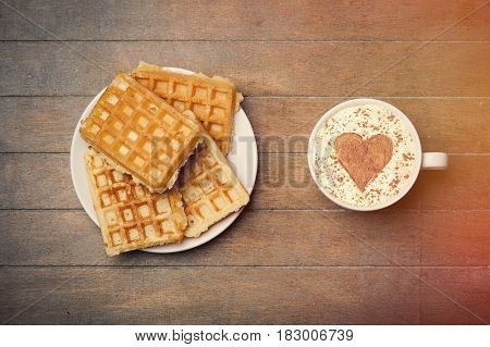 Photo Of Plate Full Of Waffles And Cup Of Coffee On The Wonderful Brown Wooden Background