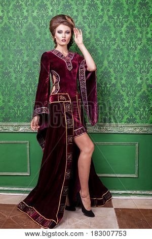 Charming woman dressed in vintage clothes in retro interior. Rococo period. Luxury and high class
