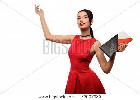 Fashion woman portrait isolated on white. female beautiful model. Girl in red dress with clutch is happy about the sale