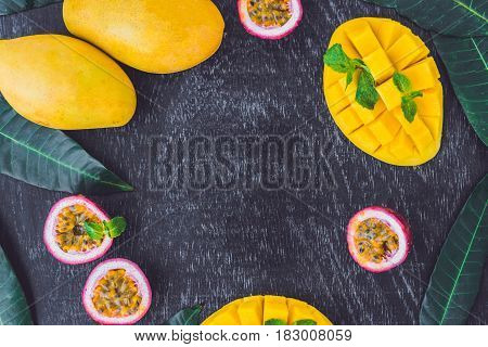 Mango And Passion Fruit On An Old Wooden Background. Copy Space