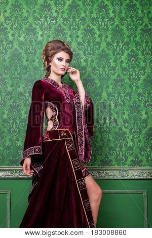 Romantic woman in vintage clothes in retro interior. Rococo period. Luxury and high class