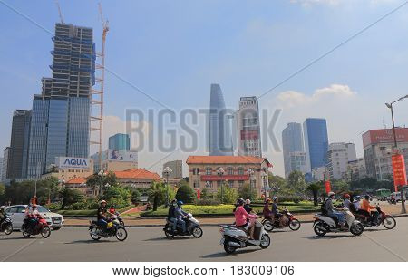 HO CHI MINH CITY VIETNAM - NOVEMBER 26, 2016: Unidentified people drive in downtown Ho Chi Minh City.