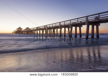 Historic fishing pier in Naples at sunset. Florida United States