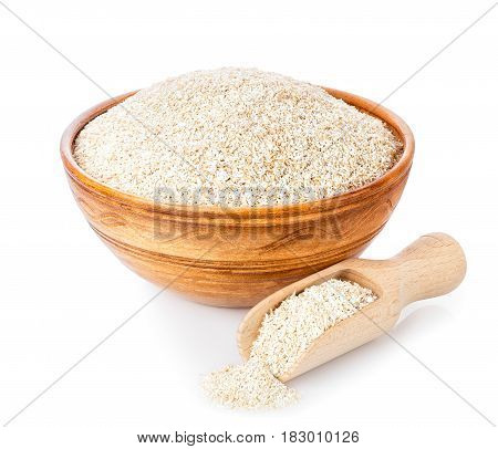 bran in bowl with wooden scoop isolated on white background. Food supplement to improve digestion. Dietary fiber. Product for healthy nutrition and diet