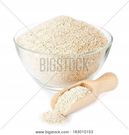 bran in glass bowl with wooden scoop isolated on white background. Food supplement to improve digestion. Dietary fiber. Product for healthy nutrition and diet