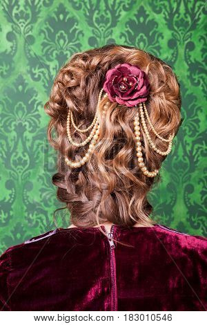 Beautiful hairstyle in vintage style in retro interior. Rococo period. Luxury and high class