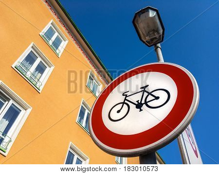 No cycling traffic sign against blue sky in a city
