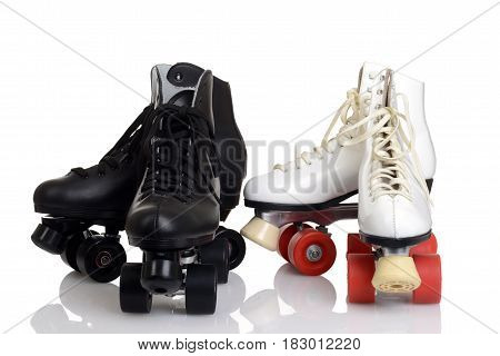 closeup men's and women quad roller skates