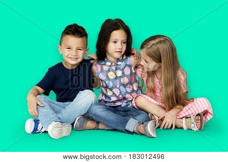 Group of little children smiling and huddle together