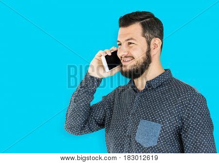 Man standing and using phone to pose for photoshoot