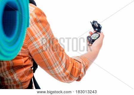 Hand Of A Tourist Holds A Compass Close-up On A White Background