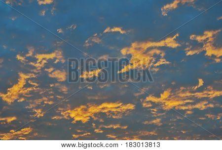 orange cloud spreading on sky in morning