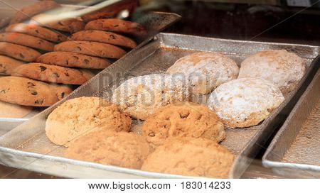 Powdered sugar scones in a pastry bakery window