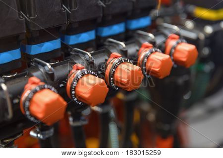 Many industrial red valves close up photo