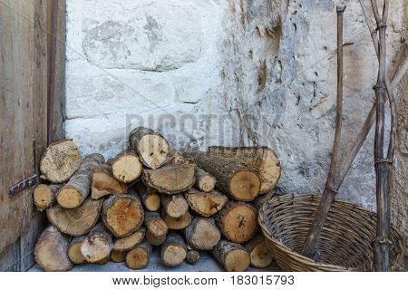 Pile of firewood with stone wall prepare for fire camp for the winter.