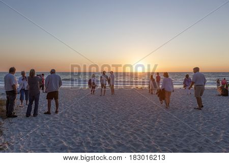Naples Fl USA - March 21 2017: People watching the beautiful sunset on the beach of Naples. Florida United States