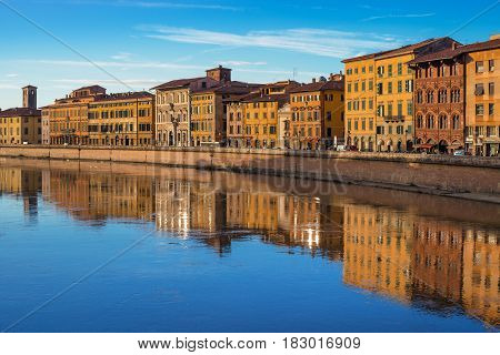 Pisa - September 2012, Tuscany, Italy: View on the Arno river at the evening time, old historical buildings reflected in the water, Lungarno Antonio Pacinotti