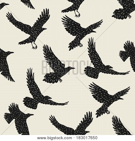 Seamless pattern with black flying ravens. Hand drawn inky birds.