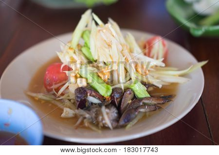 Thai delicious raw papaya salad with unique taste hot and spicy this dish with tomato and pickle crab