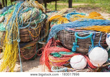 Color fishing net floats nylon rope used in fishing industry in on the beach in fishing small village.
