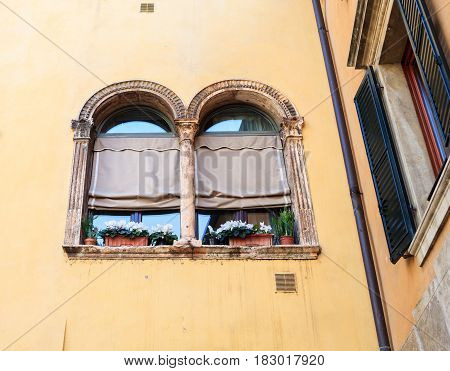 Typical double-arched window mullioned window in Verona