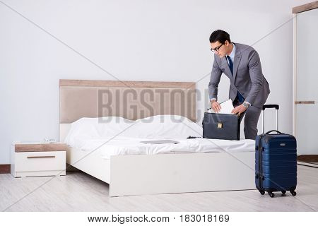 Businessman working in hotel room