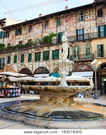 VERONA ITALY - APRIL 07: View of the Madonna fountain in Piazza delle Erbe the Market's square in Verona on April 07 2017