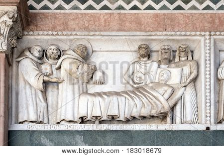 LUCCA, ITALY - JUNE 06, 2015: Detail of the bas-relief representing the Stories of St. Martin; preserved in the Portico of the Cathedral of St. Martin in Lucca, Italy, on June 06, 2015