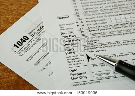 ball point pen on 1040 income tax form