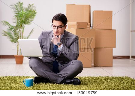 Businessman sitting on the carpet in office