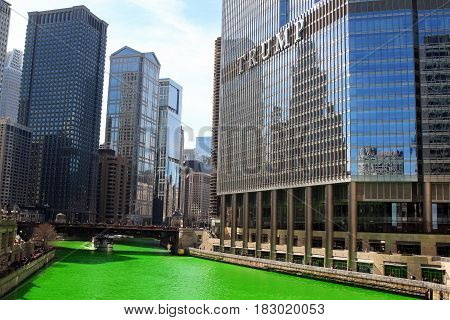 Chicago USA - March 11 2017: Green Chicago River Saint Patricks Day 2017. Michigan Avenue Bridge. River dyeing in Chicago for St Patrick's Day