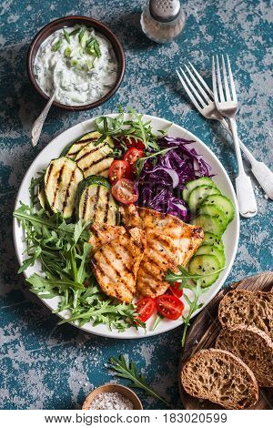 Grilled chicken breast zucchini and garden vegetable bowl. Healthy diet food concept top view. Delicious healthy lunch