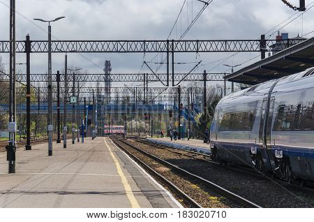 KOLOBRZEG, WEST POMERANIAN / POLAND - APRIL, 2016: Express train waiting for passengers at the platform at the train station