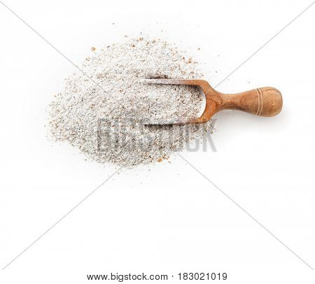 Rye flour in scoop on white background