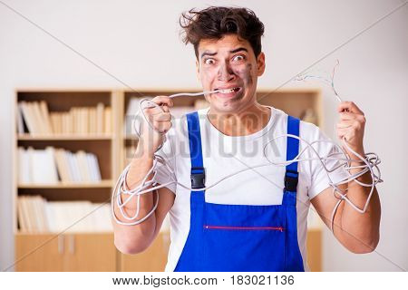 Funny Man doing electrical repairs at home