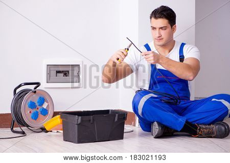 Man doing electrical repairs at home