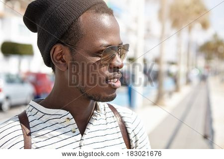 Close-up Portrait Of Handsome Young African American Male Student In Stylish Shades And Headwear Hav