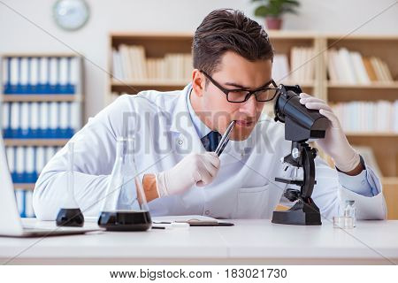 Chemical engineer working on oil samples in lab
