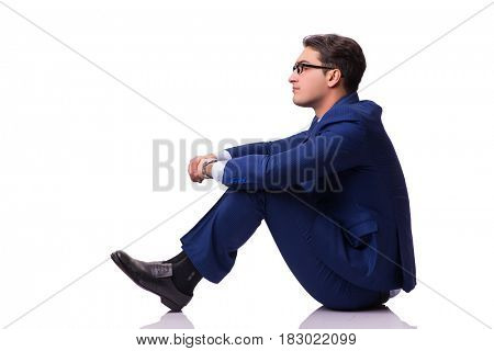 Businessman sitting on the floor isolated on white